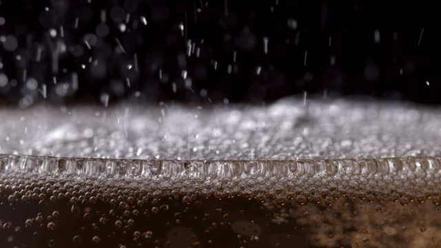 bubbly drink fizzing in glass close up - champagne stock videos & royalty-free footage