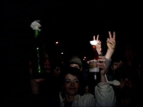 Bucharest Last Night Chanting crowds amp soldiers Armed men guarding studio entrance Soldiers stand People giving v signs Homemade molotov cocktails...