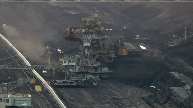 bucket excavators and other heavy mining machinery work to extract lignite coal from the pit of the jaenschwalde open-pit coal mine on october 11,... - coal mine stock videos & royalty-free footage