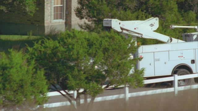 slo mo ms ts bucket truck driving down rural road / johnson city, texas, usa - johnson city texas stock videos & royalty-free footage