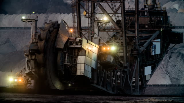 bucket wheel excavator in brown coal mine - excavator stock videos and b-roll footage