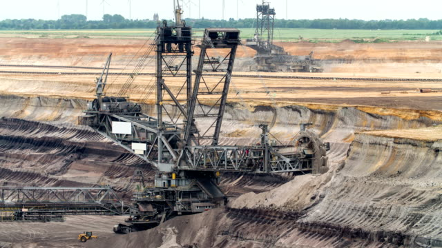 bucket wheel excavator in brown coal surface mine - pit mine stock videos and b-roll footage