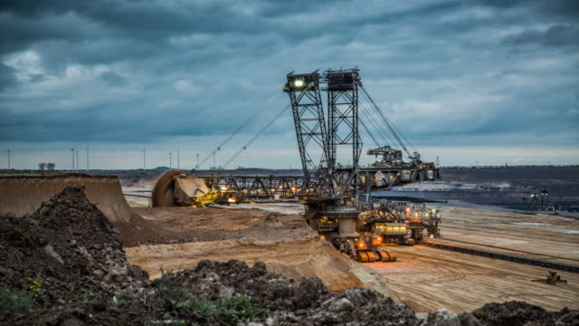 bucket wheel excavator in coal surface mine - time lapse - excavator stock videos and b-roll footage