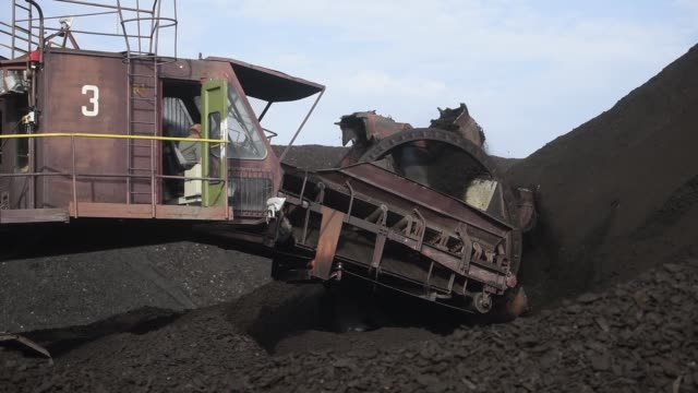 a bucket wheel excavator transports brown coal at the visonta open cast lignite mine operated by matrai eromu zrt in visonta hungary on wednesday... - bucket stock videos & royalty-free footage