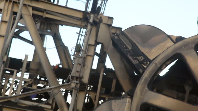 bucket wheel loading coal at a coal mine - bucket stock videos & royalty-free footage