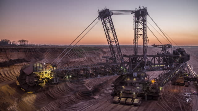 bucket-wheel excavator in open-cast coal mine in germany at dusk - bucket stock videos & royalty-free footage