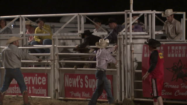 a bucking bull throws a cowboy in rodeo competition. - rodeo stock videos & royalty-free footage