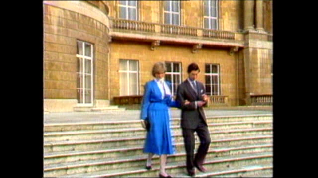 ext prince charles and then fiancee lady diana spencer along in grounds of buckingham palace on announcement of their engagement and diana with... - 1981 stock-videos und b-roll-filmmaterial