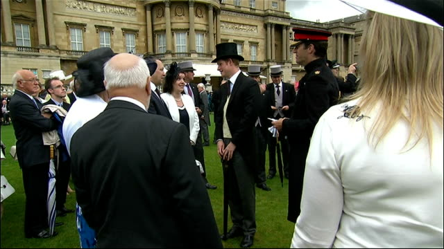 buckingham palace garden party prince harry talking to guests / princess anne meeting guests / harry meeting guests / guests along handshakes with... - top hat stock videos & royalty-free footage