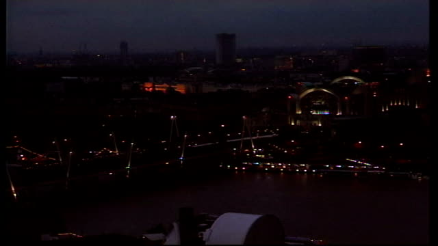buckingham palace illumination row; england: london: ext/night high angle general view of hungerford bridge over river thames high angle general view... - hungerford bridge stock videos & royalty-free footage