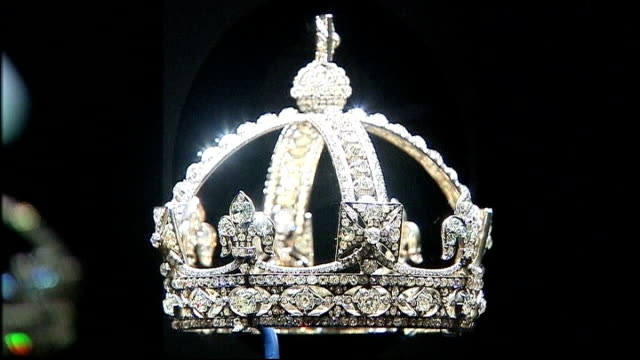 buckingham palace jewellery exhibition to mark diamond jubilee close shot diamond crown on display - crown headwear stock videos and b-roll footage