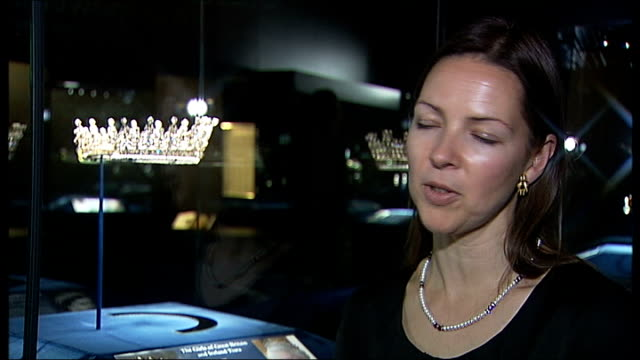 buckingham palace jewellery exhibition to mark diamond jubilee close shot 'delhi durbar' tiara on display pan exhibition information caroline de... - crown headwear stock videos and b-roll footage