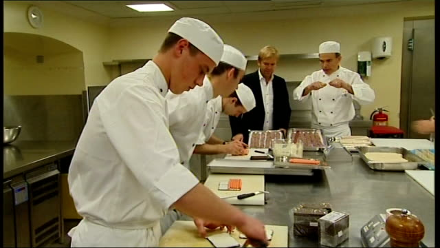 buckingham palace prepares to host reception ahead of royal visit to australia kitchen preparations granger watching as team of chefs prepare savoury... - savoury food stock videos & royalty-free footage