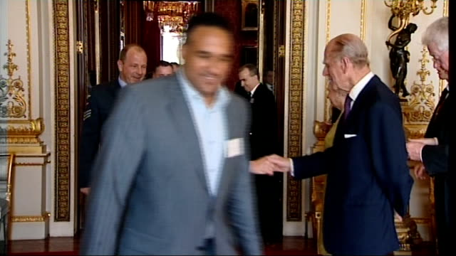buckingham palace reception for hospitality industry more guests arriving and shaking royal couple's hands including antonio carluccio michael caines - antonio carluccio stock videos & royalty-free footage