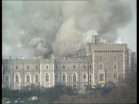 buckingham palace to be opened/ windsor's restoration nat berks windsor castle seq smoke rising from castle flames fire fought queen prince andrew... - windsor england stock videos and b-roll footage
