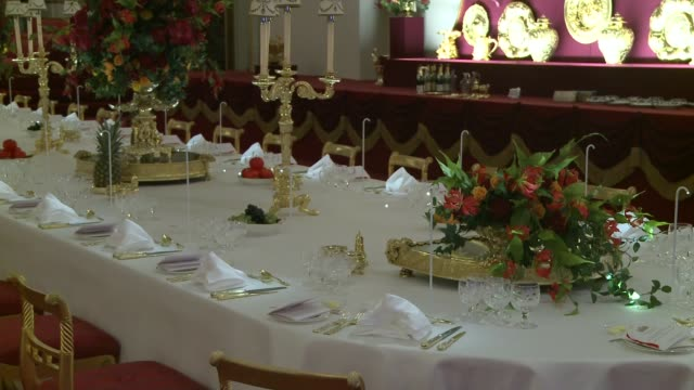 buckingham palace visitors to be shown the secrets behind a royal banquet room laid out for a state banquet gold cruet set on table place marker for... - buckingham stock videos & royalty-free footage