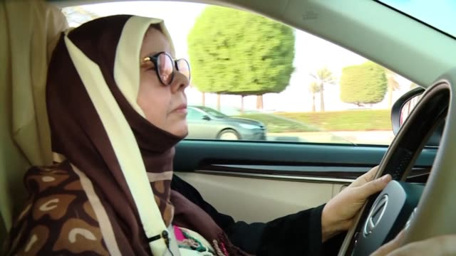 stockvideo's en b-roll-footage met buckling up in a pearl silver lexus sabeeha al fakher takes the wheel and relegates her son to the passenger seat a role reversal the 68 year old... - weduwe