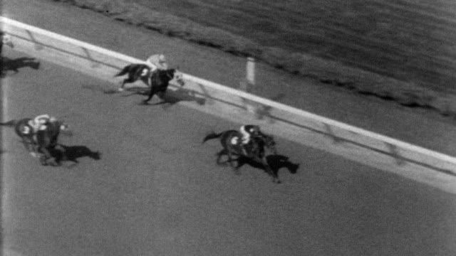 buckpasser wins aqueduct metropolitan handicap horse race / horses and jockeys make their way to starting line / buckpasser / crowd on tiptoes trying... - tiptoe stock videos & royalty-free footage