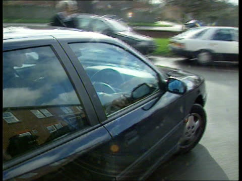 Bucks Bictester Magistrates Court TMS Damon Hill driving car towards as arrives at court PAN LR to BV TMS SIDE Hill putting on jacket as along past...
