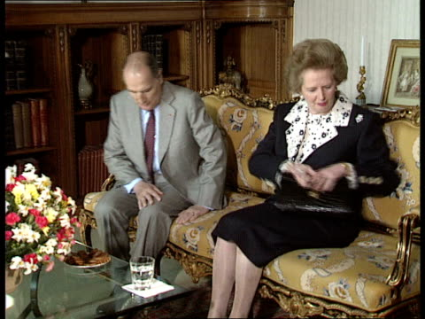 bucks: waddesdon : hall ext gv's of waddesdon manor house and gardens int mrs margaret thatcher and french pres. mitterand into room and sit together... - douglas hurd stock-videos und b-roll-filmmaterial
