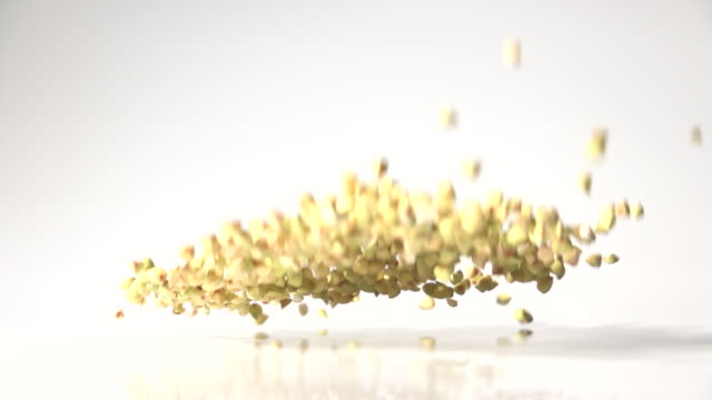 buckwheat seeds dancing captured with high speed sync - buckwheat stock videos & royalty-free footage