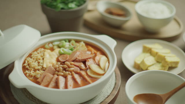 budae-jjigae (army stew) in a pot / south korea - noodles stock videos & royalty-free footage