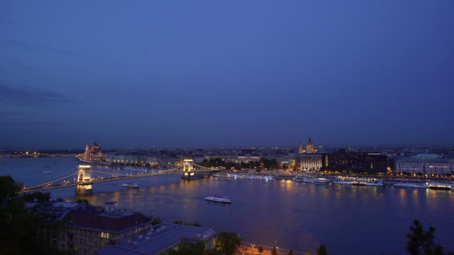 budapest and the széchenyi chain bridge at the blue hour - széchenyi chain bridge stock videos & royalty-free footage