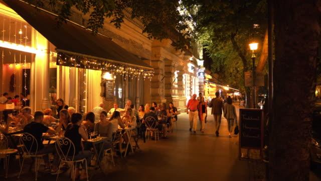 budapest andrássy út night street scene - boulevard stock videos & royalty-free footage