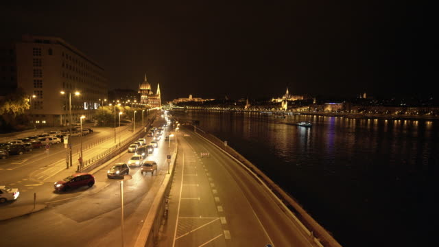 budapest at night viewed from idősebb antall józsef rakpart road - royal palace of buda stock videos & royalty-free footage