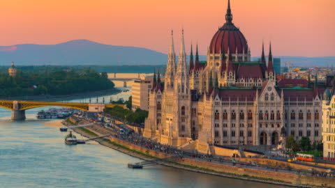 budapest city skyline with hungarian parliament and chain bridge at danube river, day to night timelapse, budapest, hungary - budapest stock videos & royalty-free footage