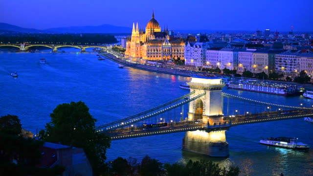 budapest city skyline with st. stephen's basilica and chain bridge at danube river, budapest, hungary - river danube video stock e b–roll