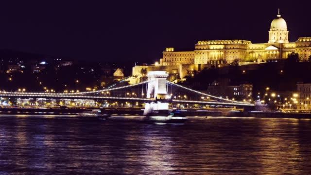budapest cityscape - chain bridge and buda hill at night - chain bridge suspension bridge stock videos & royalty-free footage