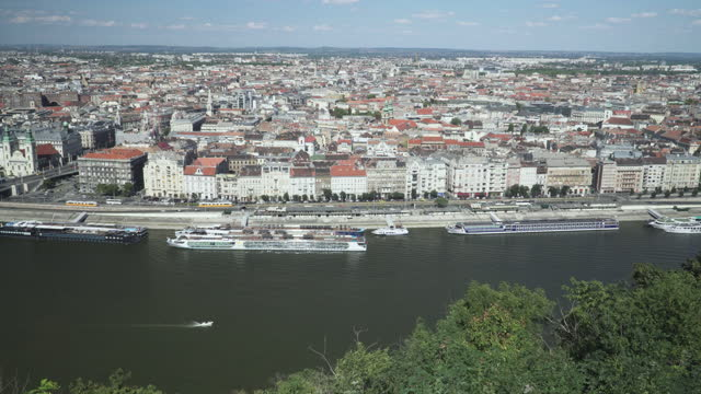 budapest cityscape view along danube river with  transportation city street view at an area of vintage cable car on elisabeth bridge, hungary including hotel boat at riverbank, panning view - traditionally hungarian stock videos & royalty-free footage