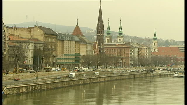 construction work / commuters / banks / river danube various wiews of river danube on grey wintry day and buildings along river including hungarian... - river danube stock videos & royalty-free footage