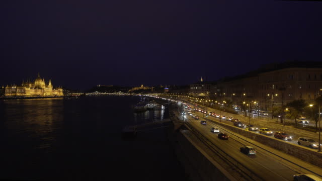 budapest danube riverside and the parliament building at night - royal palace of buda stock videos & royalty-free footage