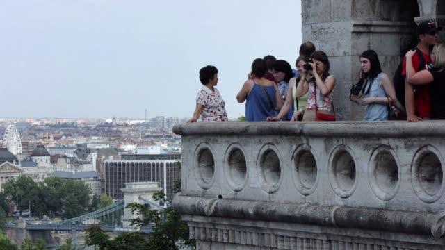 t/l budapest fisherman's bastion tourists - chain bridge suspension bridge stock videos & royalty-free footage