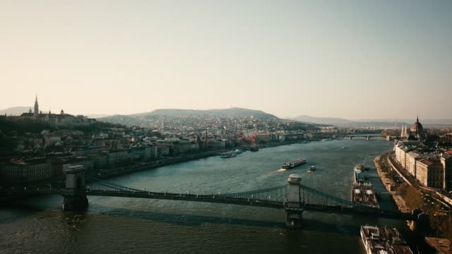 budapest hungary aerial over chain bridge - budapest stock-videos und b-roll-filmmaterial