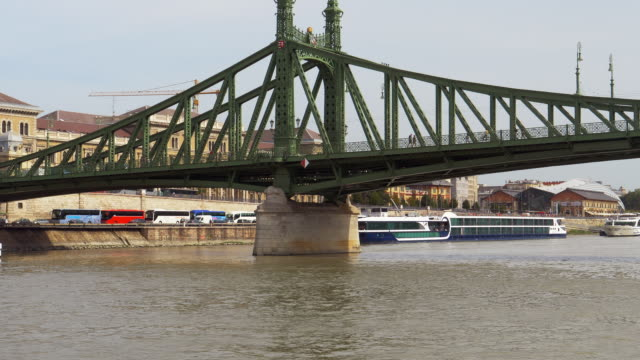 budapest liberty bridge viewed from tourboat - liberty bridge budapest stock videos & royalty-free footage