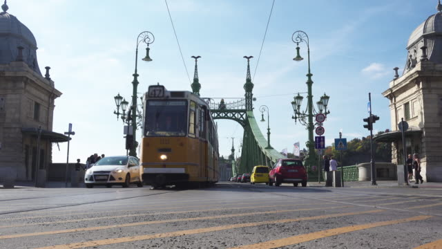 budapest liberty bridge with tram - liberty bridge budapest stock videos & royalty-free footage