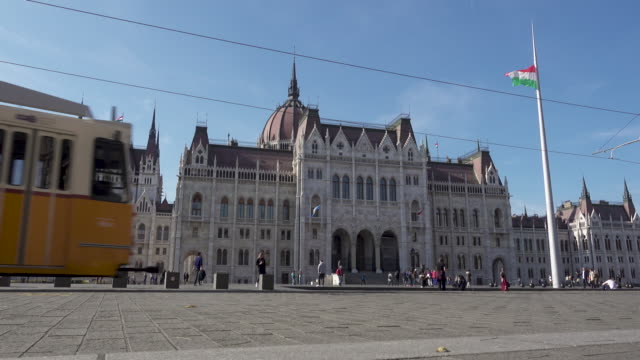 Budapest Parliament of Hungary and yellow tram