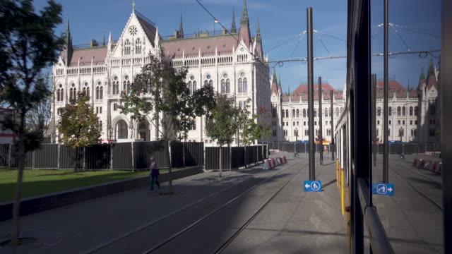 budapest parliament of hungary from a tram - osteuropäische kultur stock-videos und b-roll-filmmaterial