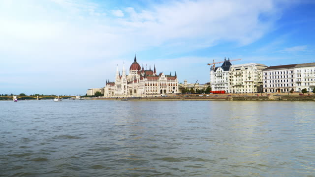 budapest pest riverbank and the parliament building viewed from tourboat - tourboat stock videos and b-roll footage