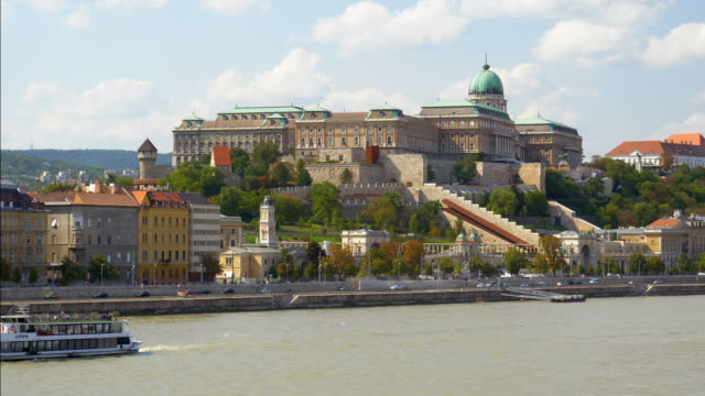 budapest royal palace of buda viewed from danube river boat - royal palace of buda stock videos & royalty-free footage