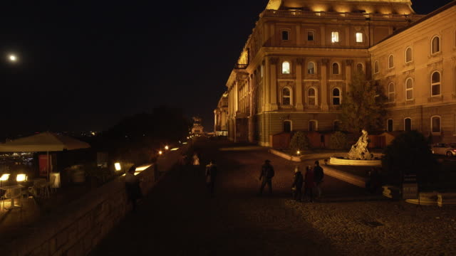 budapest sightseers visiting the royal palace of buda at night - royal palace of buda stock videos & royalty-free footage