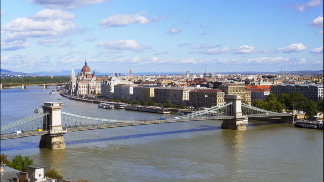 budapest skyline with chain bridge and the parliament - chain bridge suspension bridge stock videos & royalty-free footage