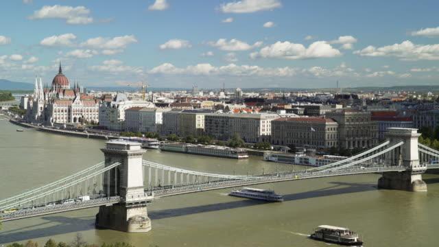 budapest skyline with chain bridge and the parliament - chain bridge suspension bridge stock videos & royalty-free footage