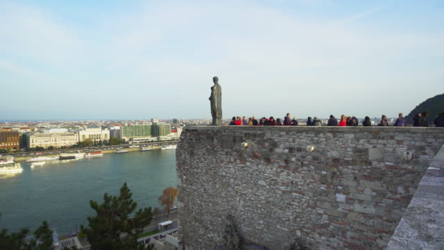 budapest tourists viewing buda skyline from castle hill - castle hill budapest stock videos and b-roll footage
