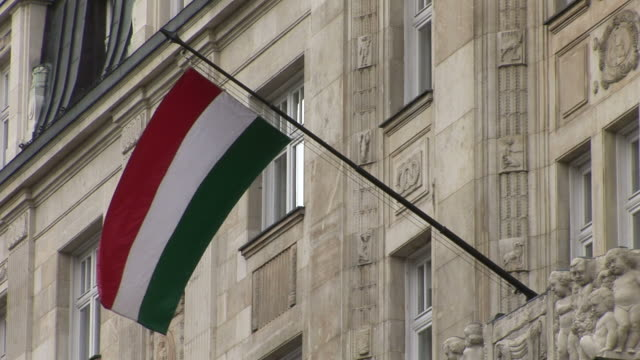 budapestclose view of hungarian flag flapping in budapest hungary - traditionally hungarian stock videos & royalty-free footage