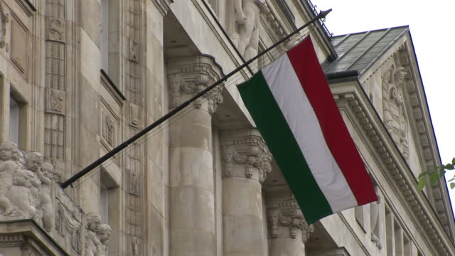 budapesthungarian flag flapping in budapest hungary - traditionally hungarian stock videos & royalty-free footage