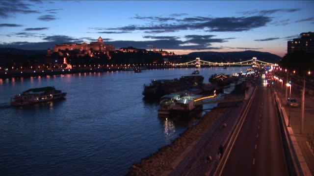 budapestroyal palace at magic hour in budapest hungary - széchenyi chain bridge stock videos & royalty-free footage